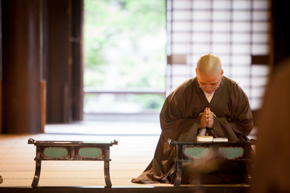Monk meditating in a traditional Japanese monastery
