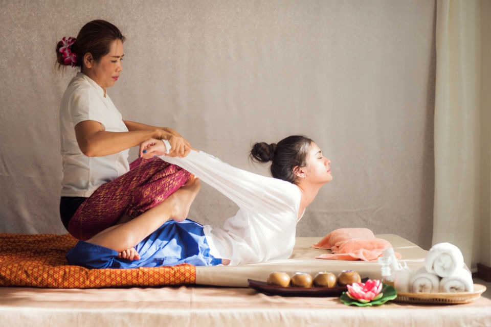 A woman giving a traditional Thai massage